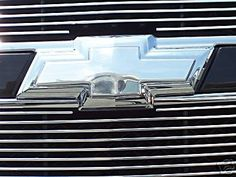 Trash that Gold bowtie that doesn't match your vehicle's  paint cover! Easy to install, just two screws.
