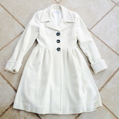 Anthro Anabel Wool Fem Coat Off white Anthro coat ;) size isn't listed inside but it's an xs. Just dry cleaned in perfect condition! Worn once. Cuffed at the wrist, fitted from bust to waist and then fabric extends and flows out like a dress ;) gorgeous and sad to let go of this! Moving makes you really cut back! Anthropologie Jackets & Coats