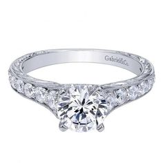 ENGAGEMENT - 1.50cttw Graduated Round Diamond Engagement Ring With Engraved Shank