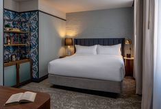 Bedroom, Dresser, Carpet Floor, Bed, Table Lighting, Wall Lighting, and Night Stands The standard King Room offers courtyard rooms and TRI-KES wallcovering.