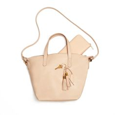 Not too big and not too small. Most people call that medium. We say it's just right. Our Small Carryall Tote functions beautifully as a go-to, everyday essential. Carry it as a satchel or wear it over your shoulder with the detachable strap. We added a gold zipper closure for security – and a touch of elegance. And the best part has to be the strong, substantial Argentine leather. It just gets better with age.