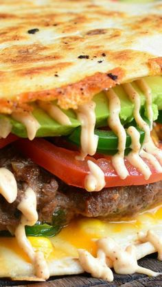 Quesadilla Burger ~ This is one amazing burger... Juicy burger in between two cheese-covered, crispy flour tortillas topped with corn, tomatoes, fresh jalapeno peppers, avocado and chipotle mayo