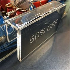 Deal piled atop deal, as already discounted Nautica Branded Tchotchkes on Sale merchandise is discounted an additional at checkout. A clear acrylic tray and label holder present Key Fobs and Lanyards Key Fobs, Visual Merchandising, Clear Acrylic, Close Up, Key Pendant, Keychains
