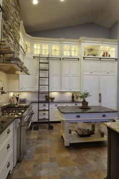 I love the ladder & taller cabinets to utilize the extra space you get with higher ceilings.