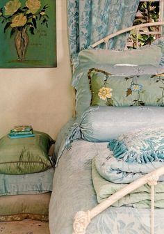 """Love the """"plumpness"""" about this special spot-plump pretty pillows, plump bed, plump roses in the paintings...lovely. And the colors too."""