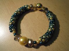 remember bracelet, green and gold