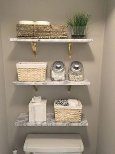 Home Interior Grey Marble wall-mounted shelves from wood shelves and toilet paper in a basket. Farmhouse bathroom remodel ideas Interior Grey Marble wall-mounted shelves from wood shelves and toilet paper in a basket. Wall Mounted Shelves, Wood Shelves, Glass Shelves, Shelf Wall, Cheap Shelves, Shelves Above Toilet, Floating Shelves, Marble Wall, Marble Shelf