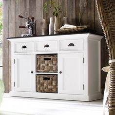 This variation on our classic buffet offers clever storage versatility. It's the ideal piece for the living or dining room, housing linens, housewares, or wine glasses.