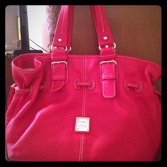 """Dooney & Bourke Medium Chiara Bag Perfect condition! Used once and still has dust bag. Red Medium Chiara Bag from Dooney & Bourke. Inside zip pocket, center zip divider pocket, inside key hook, cell phone pocket, lined, magnetic closure. L 15.5"""" W 7"""" H 11"""" great leather material. Amazing condition!!! Dooney & Bourke Bags"""