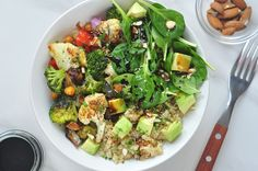 Roasted veggies and an aromatic garnish make this quinoa buddha bowl into a powerful and delicious meal.