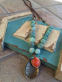 Aqua and orange on leather and chain. Boho. OOAK 68.00