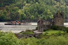 Two Scottish Icons Waverley, the last seagoing paddle steamer in the world, sailing past Eilean Donan Castle. The Highlands, Scotland. Credit: David Win
