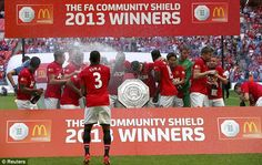 Manchester United's players celebrate their success in the season's tradition curtain-raiser