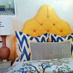 January Southern Living. Bold colors on bedding. Yellow tufted headboard. Blue & white graphic pillows. Chinoiserie print duvet.