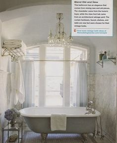 Depending on bathroom situation: framed window behind tub with chandelier