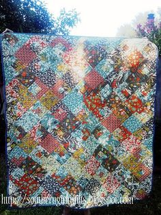 Gorgeous fabrics. Beautiful Quilt!