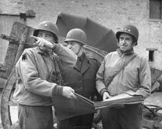The day after the Allied invasion of France, General Omar Bradley and Major  General Ralph Royce of the 9th Air Corps check map as Bradley's aide, Major Hanson indicates direction.