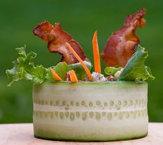 Dramatic bacon and cucumber salad. Cool presentation. May be challenging to eat though....