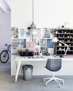length & material of desk, grid of images on wall, lamp & bin!