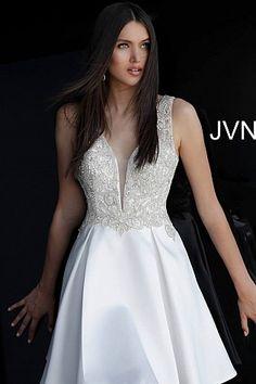 17977f833c6 White short fit and flare crystal embellished bodice v Neck dress.