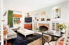Eclectic Living Room by Touch Interiors Idea for TV other than over the fireplace!