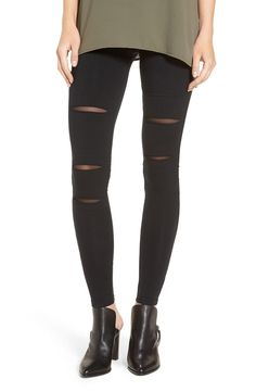 Ripped details backed with mesh and moto-inspired stitching make these leggings a style standout for fall.