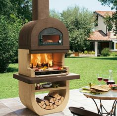 20 Modern Fireplace Design Ideas for Outdoor Living Spaces : What a great pizza oven/BBQ grill combo!