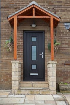 Genoa composite door in Black with satin glass.