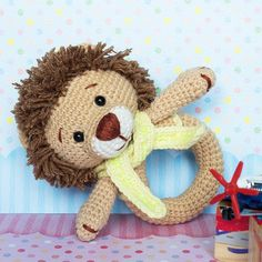 Give your little one something to gnaw on with this adorable crochet lion rattle. It is a great way for your baby to experience different textures, colors and s