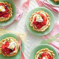 Mile-High Mini Strawberry Pies | MyRecipes.com | What's cuter than a strawberry pie? A mini strawebrry pie heaped with vanilla cream.