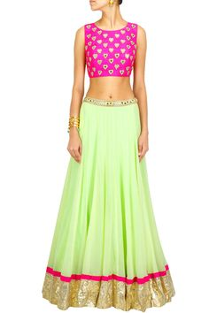 Color combi for red dress Mint green lehenga with pink heart crop choli BY ARPITA MEHTA.