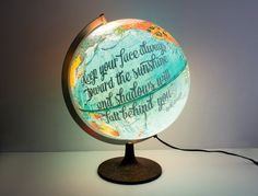 Vintage globes get a fresh spin when Laura Maxcy of Wild & Free Designs hand-letters inspirational quotes onto them.