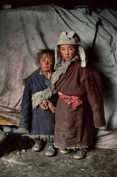 Nomad children, Amdo, Tibet. The yaks that supply a tribe's meat and milk, also supply its clothing.
