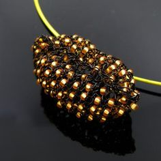 How cool are these lips??? I LOVE these!!! Black wire knit lip necklace with golden seed beads