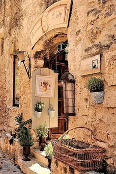coisasdetere:   Little French shops tucked in stone walls - Les Baux de Provence - France.