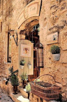 coisasdetere:  Little French shops tucked in stone walls - Les Baux de Provence - France.