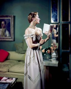 1948 — Model Lisa Fonsagrives wears a strapless gray evening gown. — Image by © Genevieve Naylor/Corbis
