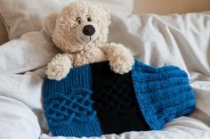 Hand knitted hot water bottle cover with by MagicAndCrochetHook