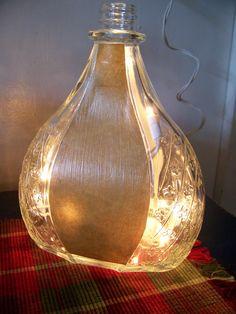 Bottle light.  Reuse any glass bottle drill hole in back of bottle 3/8 or larger glass/tile drill bit, string lights in it.