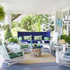 Pretty Porch    Crisp blues and leafy greens are ideal for outdoor decorating, particularly in seaside locations. And from the blue-painted floorboards to the striking royal blue upholstered swing, this colorful porch recalls the ever-changing colors of its nautical surroundings. Leaving the furniture white allows the bold blue hues and playful patterns to shine.