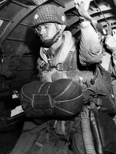 A paratrooper about to jump into the Norman night, June 6, 1944. Image