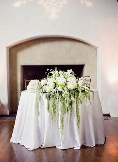 Couple's Table with cascades of white and green flowers