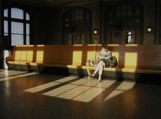Homage To Edward Hopper - Solitude At A Railroad Station : Most of Hopper's figure paintings focus on the subtle interaction of human beings with their environment—carried out with solo figures, couples, or groups. His primary emotional themes are solitude, loneliness, regret, boredom, and resignation and he demonstrates these emotions in various environments, including the office, in public places, in apartments, on the road, or on vacation. Like stills for a movie or tableaux in a play,
