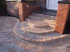 Natural Indian sandstone cobbles with granite risers to create half moon feature steps