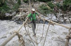 A man crosses a rope bridge over the Alaknanda river during rescue operations in Govindghat in the Himalayan state of Uttarakhand June 23, 2013. REUTERS/Danish Siddiqui Posted by floodlist.com #floods #uttarakhand