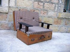 Suit cases are can be very easily and beautifully converted into sofa seats, chairs or ottomans. The one in picture is not only a single option for converting suitcase into a sofa seat. You can do a lot. Empty the suitcase and fill in some soft upholstery and use the back cover of suitcase as back rest.