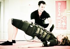 bodytec-with-personal-trainer-hip-lifts
