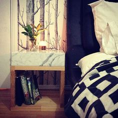 Feeling bored with your plain nightstand? Top it with a chunk of your favorite surface, like marble or acid-treated concrete.  Source: Instagram user k_trula
