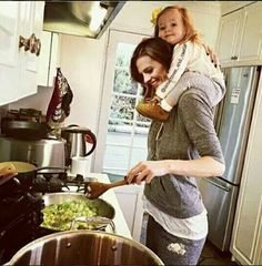 Stana babysitting o m g  Photoshopped, but awesome!