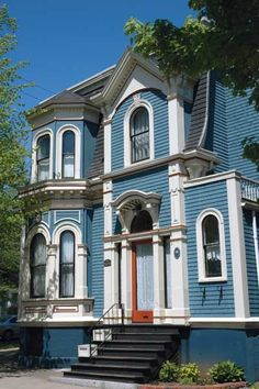 Taking its cue from the surrounding sky and clouds, this blue-and-white-painted Italianate-style house feels cheery and energetic. | Courtesy of: Sherwin-Williams | thisoldhouse.com